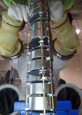 GERDA's germanium detectors are assembled on a string to be lowered into an argon tank. (Photo: B. Schwingenheuer/GERDA Collaboration)