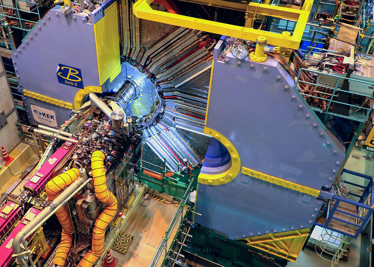The Belle II detector records and analyses particle collisions produced by SuperKEKB.